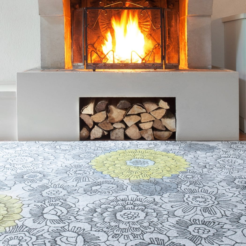 One of Wendy Morrison's interesting neutral rugs. Yellow ochre florals pop out from a grey sketchy floral base to create warmth and add interest.