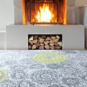 A Wendy Morrison neutral rug. Yellow ochre florals pop out from a grey sketchy floral base to create warmth and add interest.