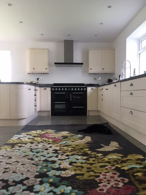 A stunning rug in a stunning kitchen.