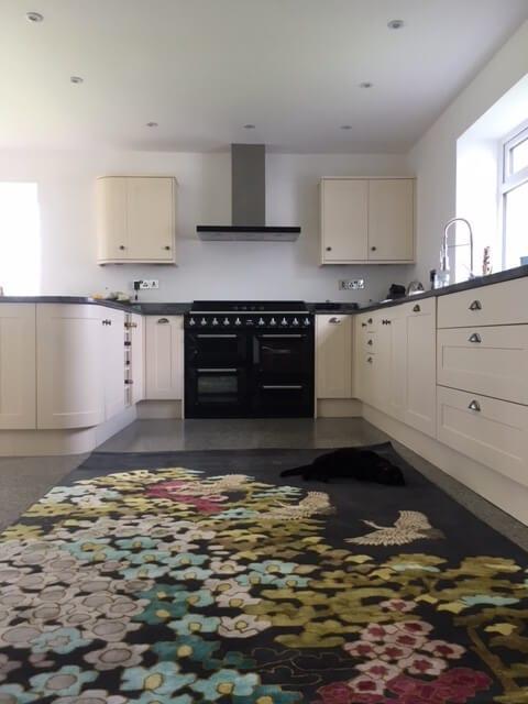 A stunning rug in a stunning kitchen.