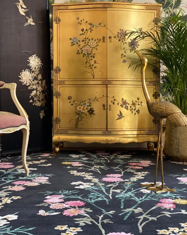 Gold chinoiserie decor with Flowers of Virtue rug