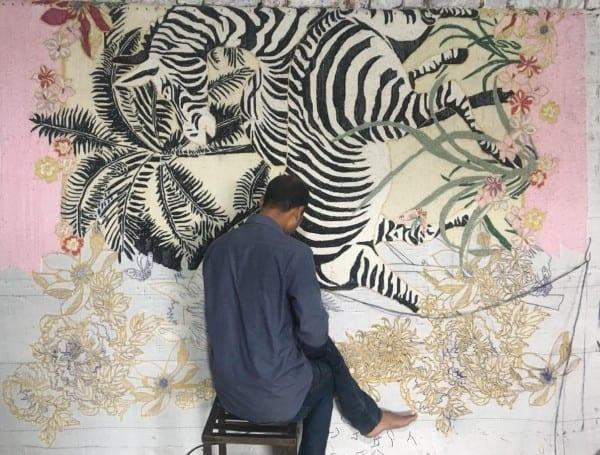 Hand-tufting of Zebra Waltz pink rug