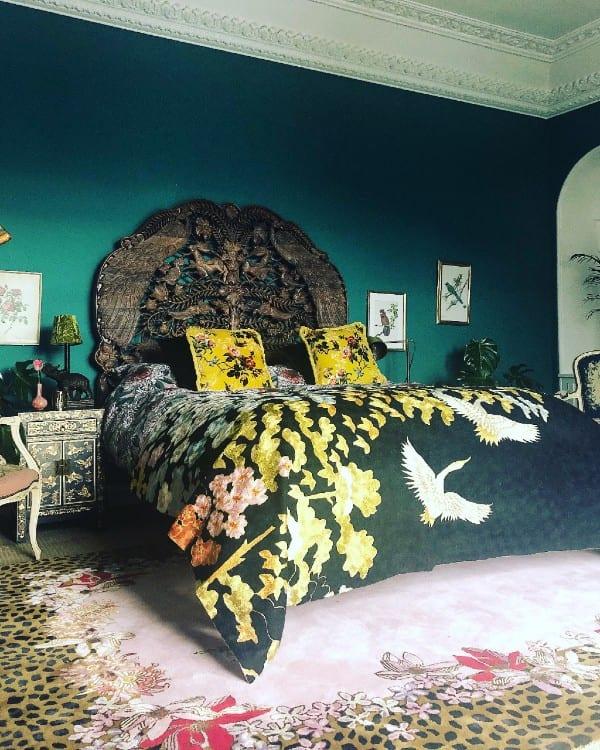 Leopard Florals rug frames the bed