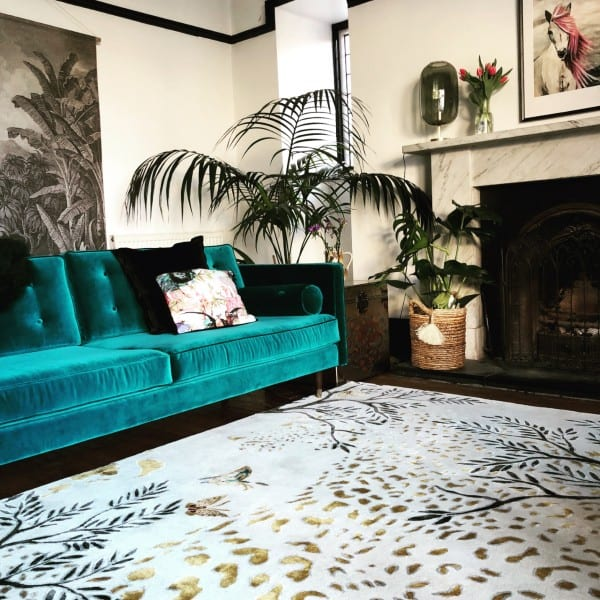 Leooard Gold rug in living room with teal sofa