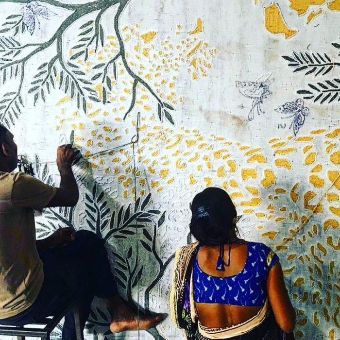 Artisans working on rug